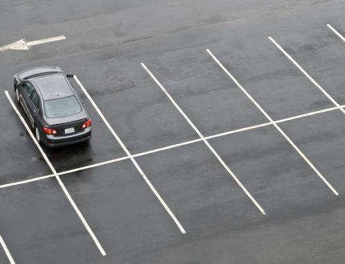 The Most Common Ways Parking Lots Get Damaged Over Time and When You Should Call a Commercial Parking Lot Paving Company
